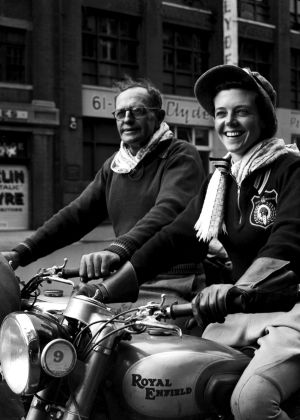 Miss Winnifred Wells of Perth with her father Who rode from Perth to Sydney in 1952 on her Royal Enfield 350 Bullett.