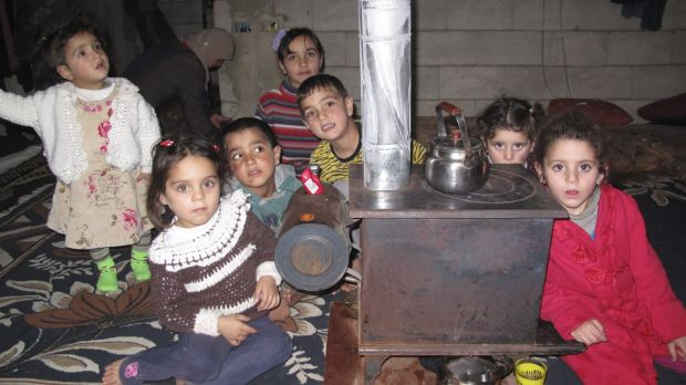 Uncertain future: Some of the 11 Syrian refugee children who live in the small room.