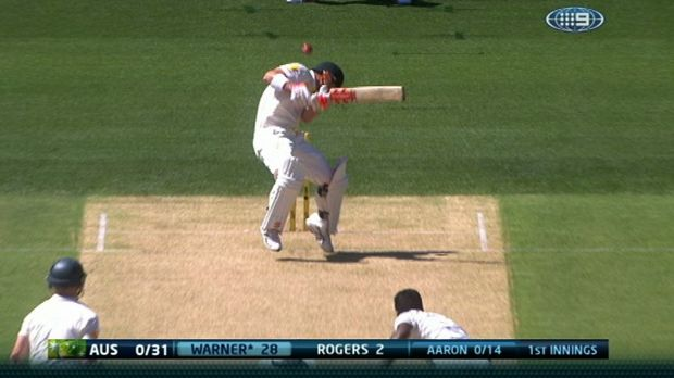 Australia's opening batsman David Warner ducks beneath the first bouncer of the Test series against India.