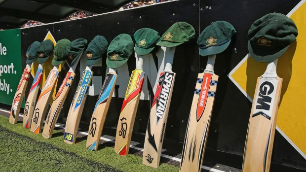 Cameraderie: The bats and caps of the Australian cricket team are left by the field in a tribute to the late Phillip ...