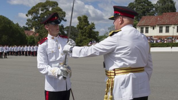 Proud moment: Senior Under Officer William Leben, left, receives the Sword of Honour from Governor-General Sir Peter ...