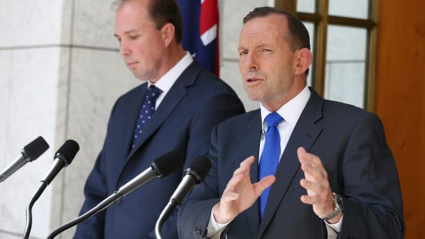 Prime Minister Tony Abbott, pictured with Health Minister Peter Dutton, has conceded the government's planned $7 GP fee ...