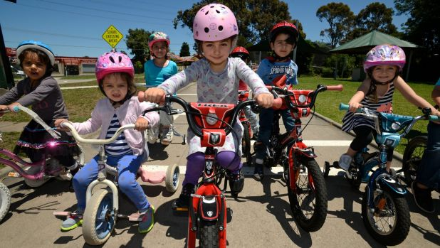 Helmets on: children learning to ride at Essendon Traffic School.