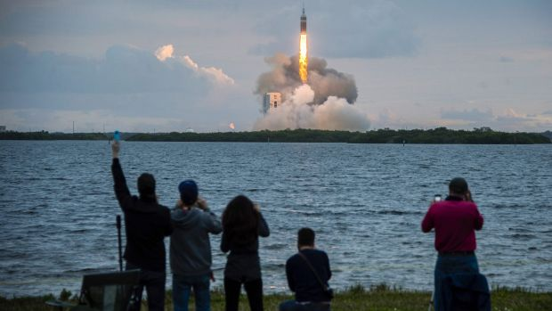 Blast off: Spectators cheer the launch of NASA's Orion spacecraft.
