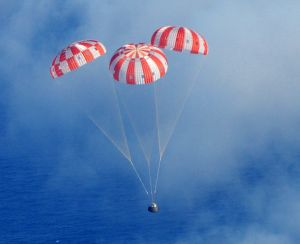 Falling to Earth: The Orion Crew Module descends into the Pacific Ocean.