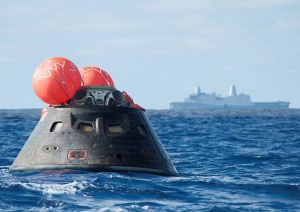 Splash down: Orion awaits the USS Anchorage.