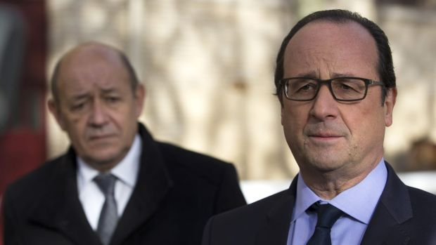 'France has no more hostages, in any part of the world ... French President Francois Hollande, right, flanked by Defence ...