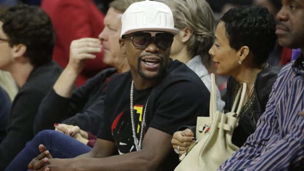 Floyd Mayweather was photographed sitting courtside at a basketball game between the Los Angeles Clippers and the ...