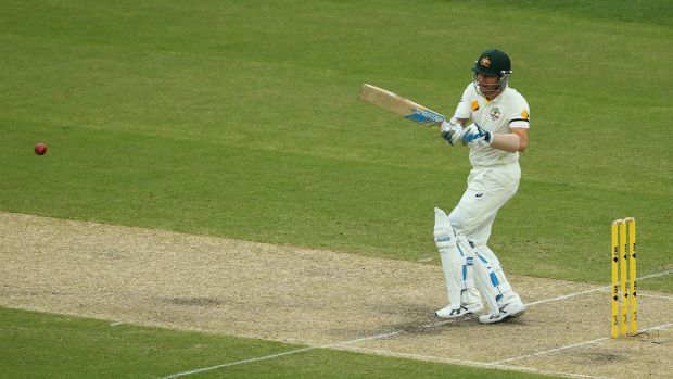 Injured captain Michael Clarke bats on day two.