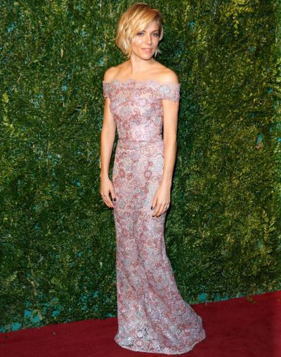 Sienna Miller attends the 60th London Evening Standard Theatre Awards at London Palladium on November 30, 2014 in ...