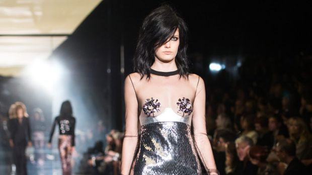 A model hits the catwalk for Tom Ford.