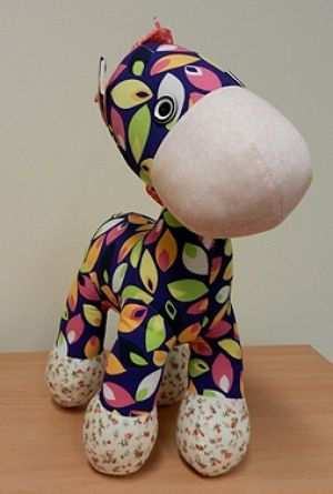 This plush giraffe failed the small parts test,  the reasonable foreseeable abuse test, and the tension test.