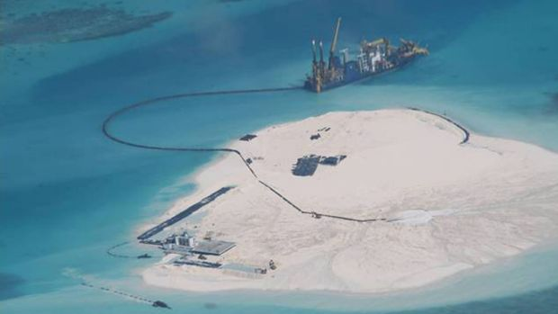 A February 2014 photo taken by surveillance planes for the Philippines government shows Chinese construction work on ...