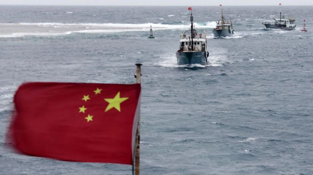 Chinese fishing vessels near the disputed Meiji reef in the South China Sea in July 2012.