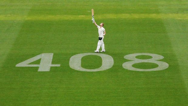 Steve Smith salutes Phillip Hughes after making his century.
