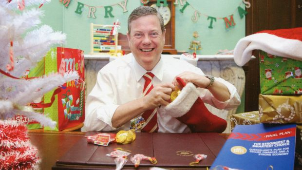 It's that time of year when Queensland politicians, including Treasurer Tim Nicholls, do their bit for Christmas cheer.