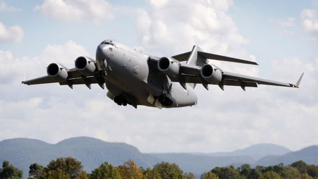 A RAAF C-17A Globemaster flew over Canberra for the ADFA parade yesterday.