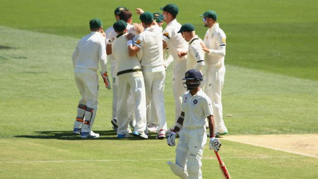 The Aussies celebrate the wicket of Shikhar Dhawan.