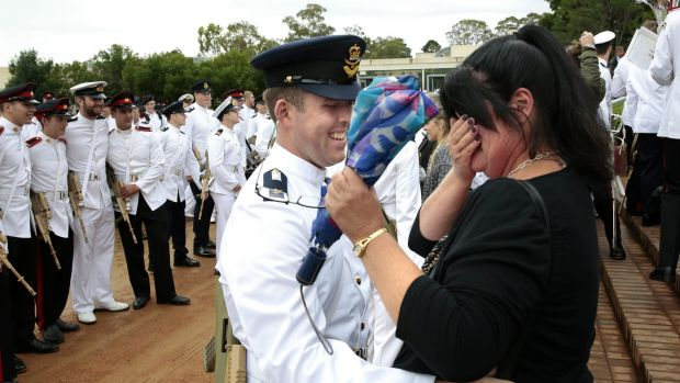 Memorable moment: Graduate Air Force Officer Cadet Joshua McNickle hugs from his mother Vicki Collins.