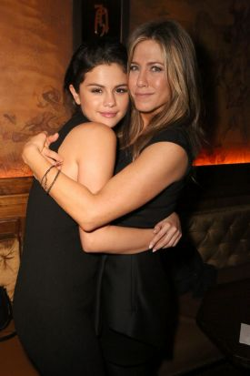 Selena Gomez and actress Jennifer Aniston on the red carpet.