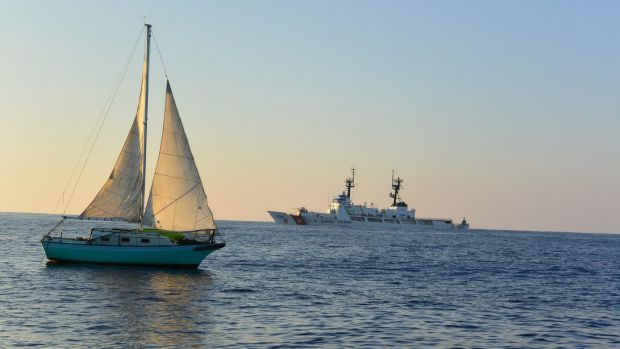 The sailing vessel is towed back to Hawaii after spending 12 days lost at sea.