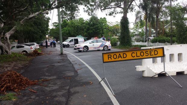 Police set up road blocks around the scene of a police shooting in Ashgrove.