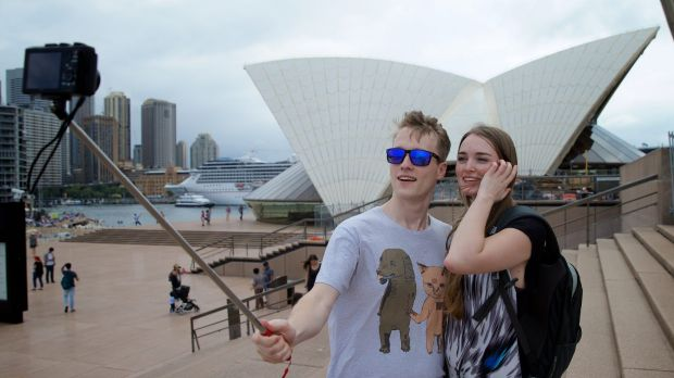 Great trick:  Alex Kyling and Linda Keizer use a selfie stick at the Opera House.