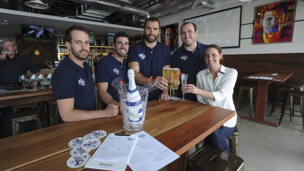 Business partners and Brumbies teammates, Scott Fardy, third from left, and Ben Alexander, fourth from left, with other ...