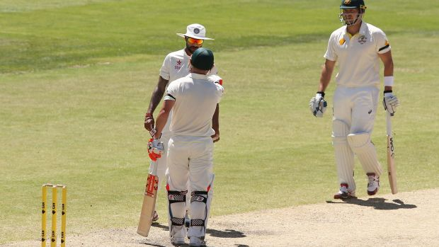 India's Shikhar Dhawan and Australian opener David Warner exchange words on the fourth day of the first Test.