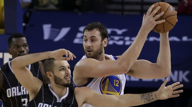 Mine: Andrew Bogut keeps the ball from Orlando Magic guard Evan Fournier.