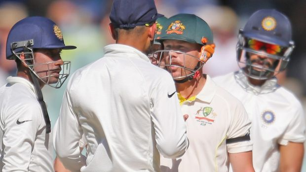 David Warner and Virat Kohli face up after the Australian exchanged words with Varun Aaron after being bowled on a no ball.