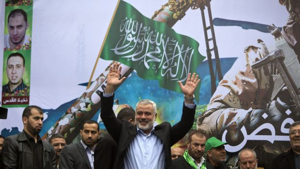 Gaza Hamas leader Ismail Haniya greets supporters during a rally to commemorate the 27th anniversary of the Islamist ...