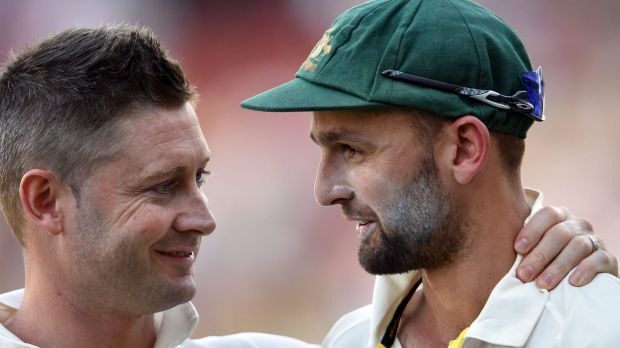 Well done, mate: Michael Clarke speaks with Nathan Lyon after beating India on the final day of the first Test between ...