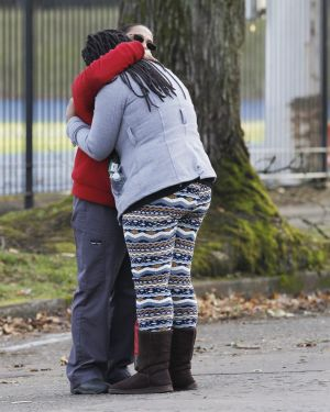A student is reunited with a family member outside the Rosemary Anderson High School in Portland, Oregon, on December ...