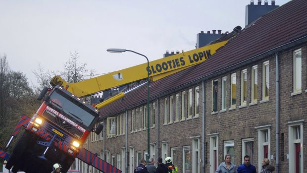 A crane crashed into the roof of a house when a man's wedding proposal went wrong.