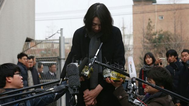 Korean Air executive Cho Hyun-Ah bows and seeks forgiveness when speaking to media after standing down over the 'nut ...