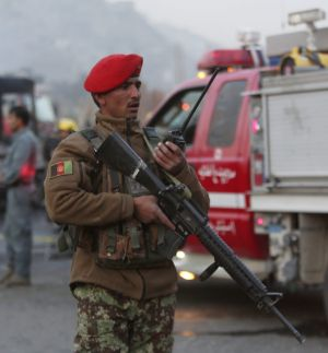 An Afghan soldier at the scene of the suicide attack, the second targeting Afghan forces in the capital in the last week.