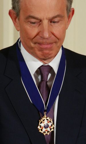 Tony Blair with the Presidential Medal of Freedom after he was decorated by George W. Bush in January 2009.
