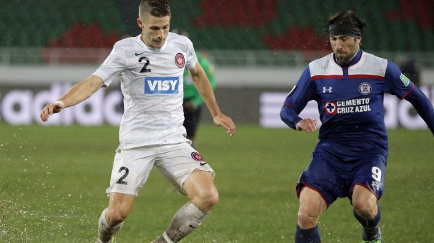 Going in hard: The Wanderers' Shannon Cole battles with Cruz Azul's Mariano Pavone in Rabat.