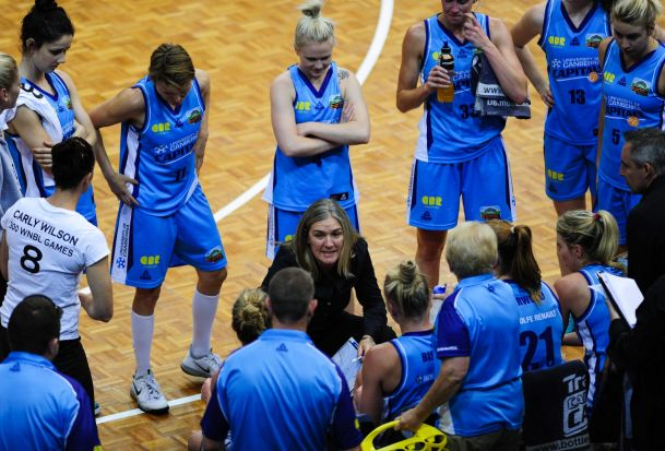 Canberra Capitals  coach Carrie Graf chats to the team at half time