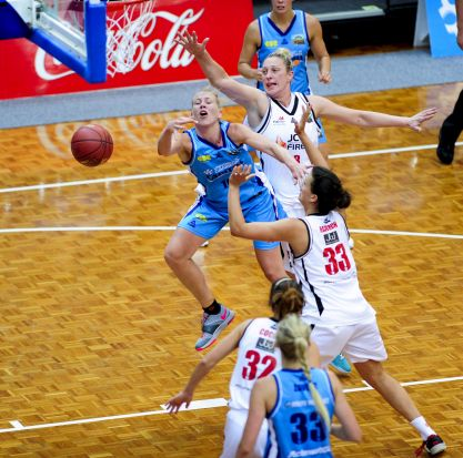 Left, Canberra Capitals player Abby Bishop in action as Townsville Fire player Suzy Batkovic challenges for the ball.