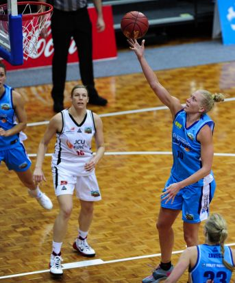 Right, Canberra Capitals player Abby Bishop in action.