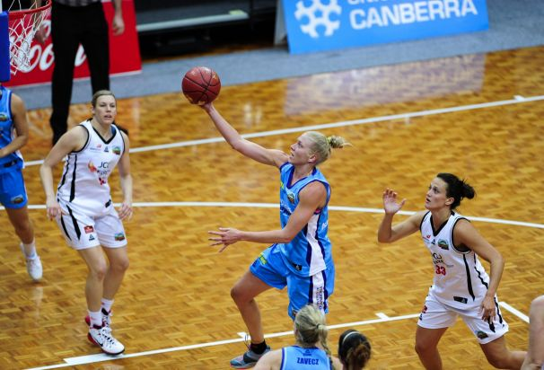 Centre, Canberra Capitals player Abby Bishop in action.