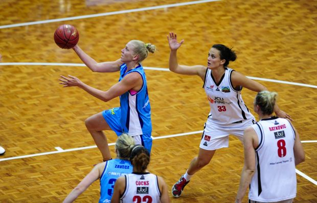 Left, Canberra Capitals player Abby Bishop in action.