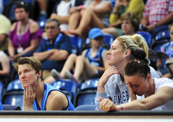 From left, Canberra Capitals players Jess Bibby and Lauren Jackson watch from the sideline.