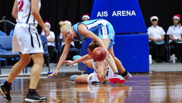 Canberra Capitals player Abby Bishop and Townsville Fire player Suzy Batkovic in action.