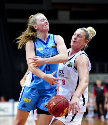 left, Canberra Capitals player Abbey Wehrung and Townsville Fire player Suzy Batkovic in action.