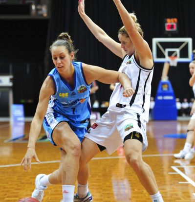 From left, Canberra Capitals player Steph Talbot and Townsville Fire player, Stephanie Cumming in action.
