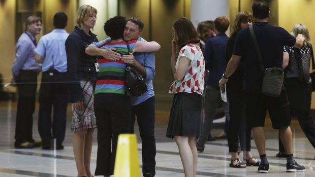 ABC staff embrace at ABC studios in Ultimo after a meeting held by ABC CEO Mark Scott announcing widespread staff cuts ...