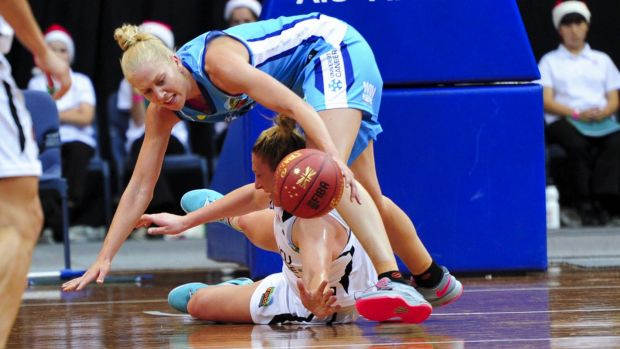 Abby Bishop tried hard but couldn't lift the Canberra Capitals to a win over Townsville Fire at the AIS Arena.
